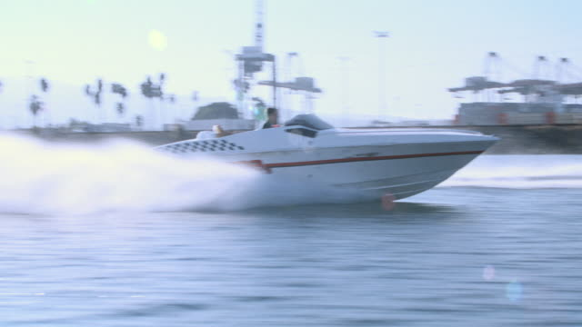 dx - boat chase-motor boat/speed boat-harbors/marinas/docks-fishing boat - speed boat stock videos & royalty-free footage