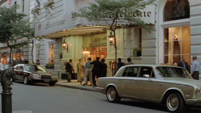 dx - late afternoon - new orleans - hotel - limousine - carriage - rolls royce stock videos & royalty-free footage