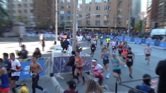 runners reach 26 miles mark as they enter central park - salmini stock videos & royalty-free footage