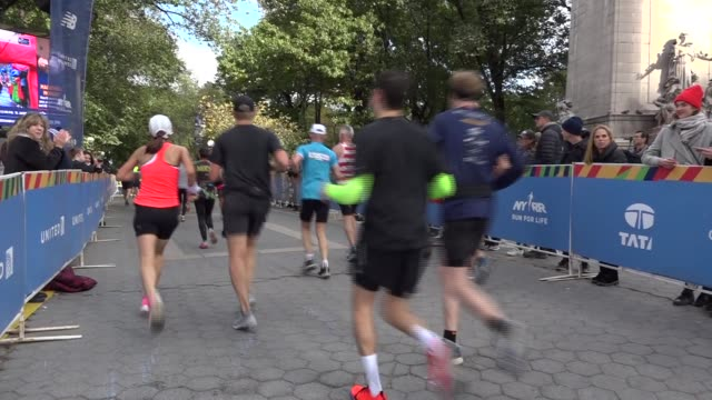 runners enter central park - salmini stock videos & royalty-free footage