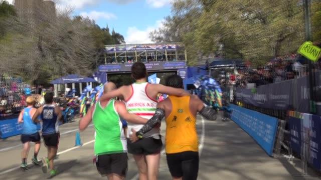 26 mile mark- helping hurt runner - salmini stock videos & royalty-free footage