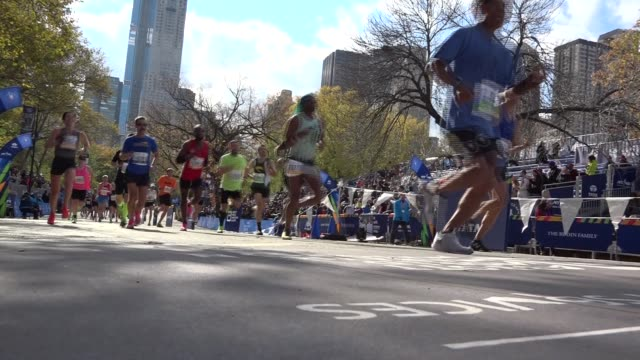 happy runners celebrate final yards- low angle - salmini stock videos & royalty-free footage