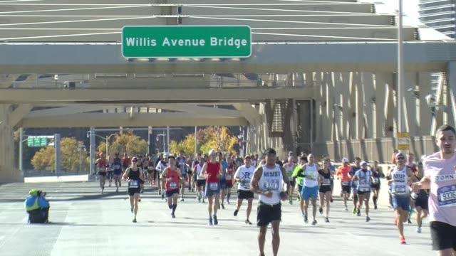 runners cross into the bronx on the willis avenue bridge - salmini stock videos & royalty-free footage