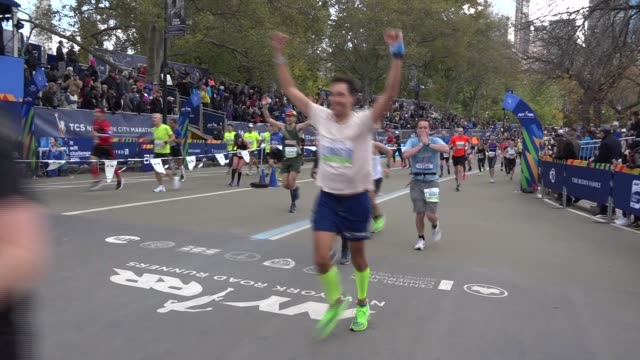 happy runners celebrate final yards - salmini stock videos & royalty-free footage