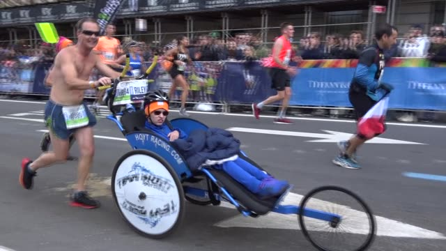 runners pushes wheelchair - salmini stock videos & royalty-free footage