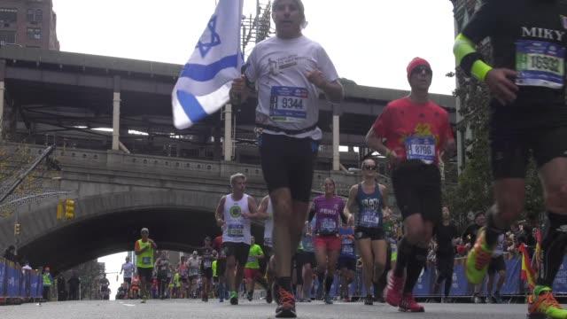 spectators greet runners at 16 mile mark - salmini stock videos & royalty-free footage