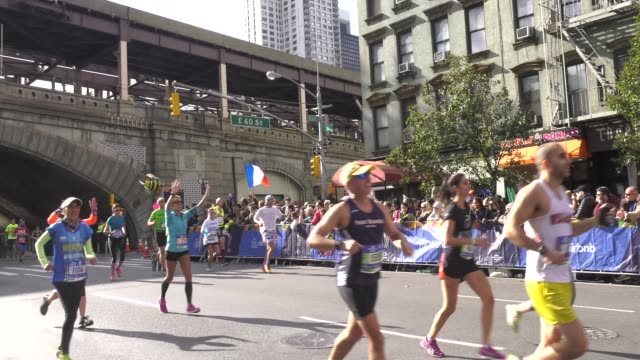 spectators greet runners at 16 mile mark - salmini stock videos & royalty-free footage