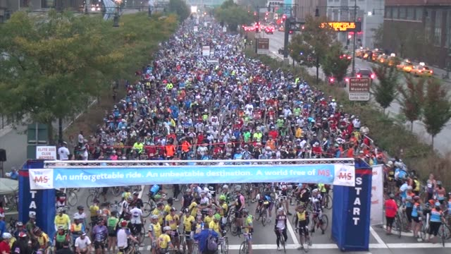 thousands of cyclists prepare for start of bike a charity cycling event - salmini stock videos & royalty-free footage