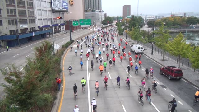 thousands of cyclists head down west side drive at start of bike a charity cycling event - salmini stock videos & royalty-free footage