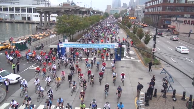 thousands of cyclists start of bike a charity cycling event on west side drive - salmini stock videos & royalty-free footage