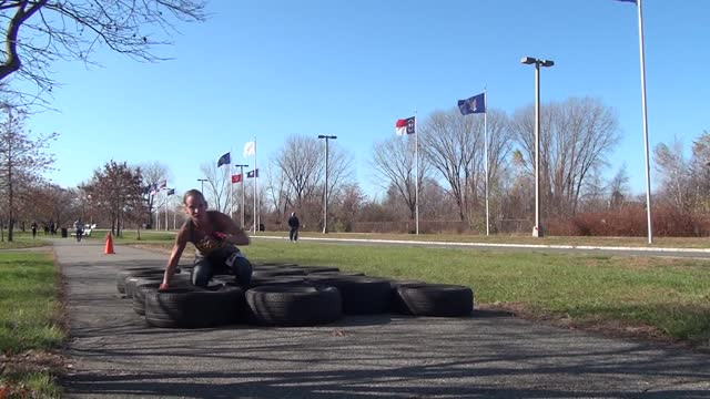 woman falls in tire maze, gets up and keep going - salmini stock videos & royalty-free footage