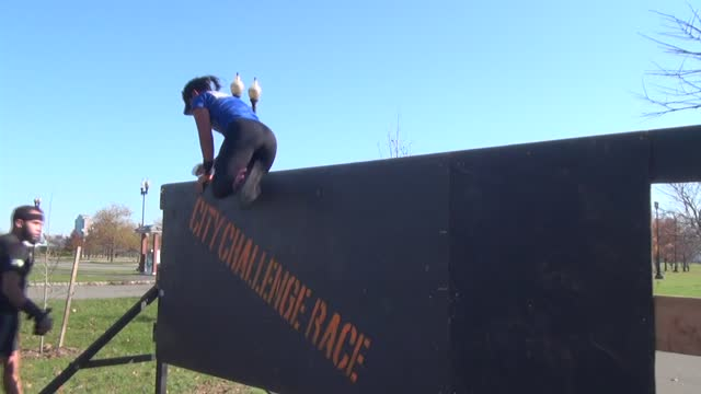 woman over top of wall obstacle - salmini stock videos & royalty-free footage
