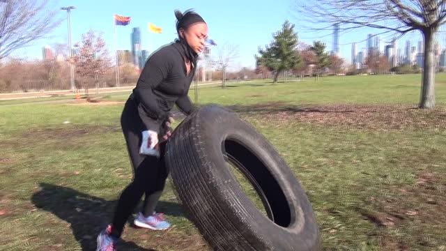 black woman flips 80 pound tire - salmini stock videos & royalty-free footage