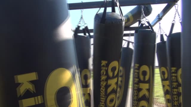 camera works its way through kickboxing bags maze - salmini stock videos & royalty-free footage