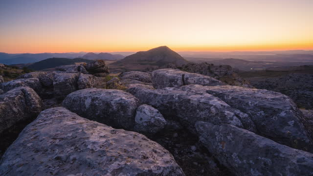 sunset timelapse in a karstic landscape - day to sunset stock videos & royalty-free footage