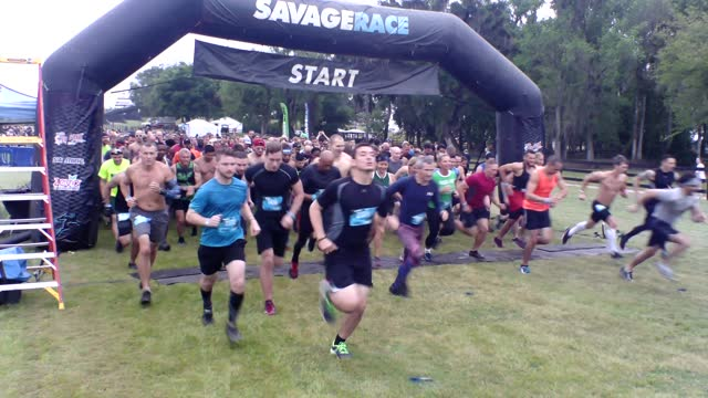 starters head out for a seven mile adventure with 15 obstacles up ahead - salmini stock videos & royalty-free footage