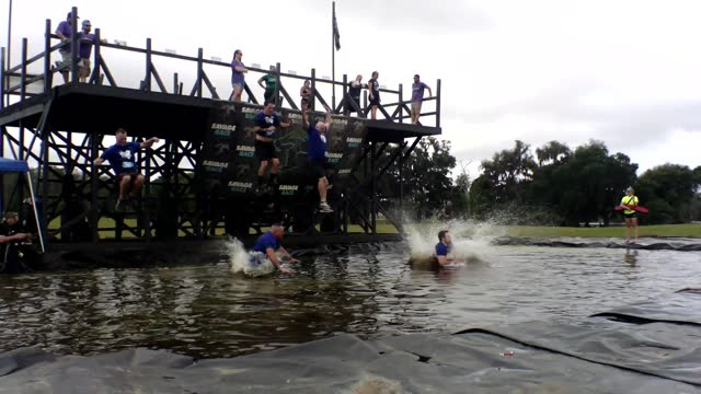 """""""new"""" teammates jump together into water - salmini stock videos & royalty-free footage"""