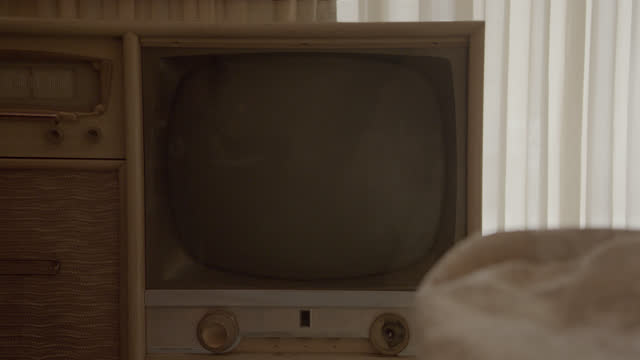 medium angle of analog television set with radio partially visible. could be hotel or motel room. television is off. could be for burn-in. - 1956 stock videos & royalty-free footage