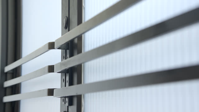 medium angle of frosted glass doors with silver handle bars. could be entrance to office building, bank, or doctors office. - security screen stock videos & royalty-free footage