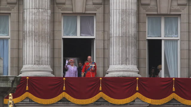 The Monarch Queen Elizabeth on her Official Birthday, comes out to greet the people , and the Royal Family come on to the Balcony at Buckingham Palace at the end of the ceremony of Trooping the Colour to view the flypast of the Royal Airforce jet aircraft