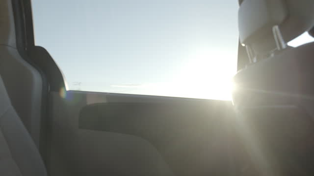 close angle from inside backseat of car. could be child pov. camera faces left back window. blue sky and clouds visible. american southwest, could be arizona. - passenger seat stock videos & royalty-free footage