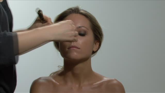 TIME-LAPSE OF A YOUNG WOMAN BEING MADE UP