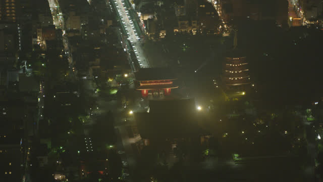 aerial of sensoji temple or asakusa kannon temple with hozomon gate and pagoda visible. nakamise shopping street partially visible. tourist and religious area. historic buddhist temple. - shrine stock videos & royalty-free footage