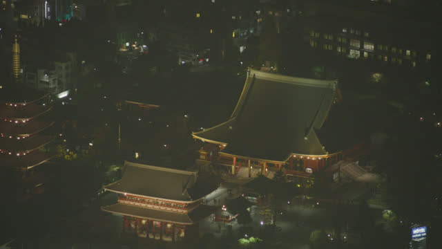 aerial zoom in on sensoji temple or asakusa kannon temple with hozomon gate and pagoda visible. tourist and religious area. historic buddhist temple. - shrine stock videos & royalty-free footage