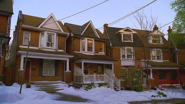 older 2-story brick houses, snow on ground; cba (toronto, ontario, canada) - veranda stock videos & royalty-free footage