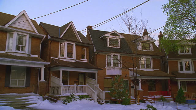 older 2-story brick houses, snow on ground; cba (toronto, ontario, canada); zoom in - veranda stock videos & royalty-free footage