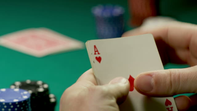 full house-aces and eights-poker hand-1080hd - casino cards stock videos & royalty-free footage