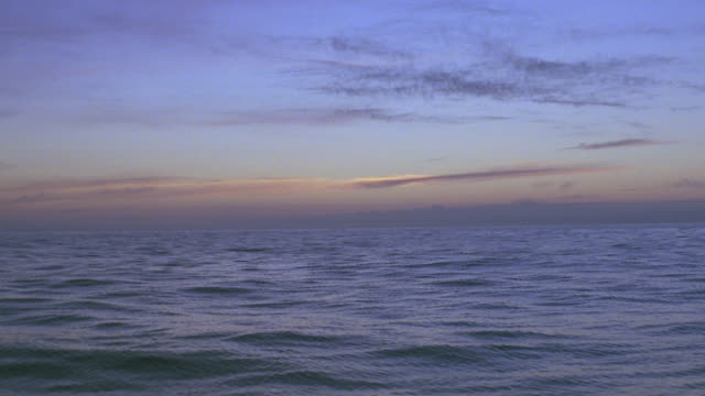 sunset ocean; pov from boat - seascape stock videos & royalty-free footage