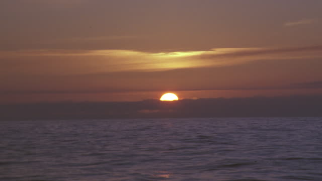 sunset ocean; pov from boat - pacific ocean stock videos & royalty-free footage