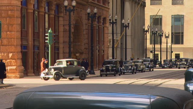 period 1930's n-d big city street w/activity (chicago) - reenactment stock videos & royalty-free footage