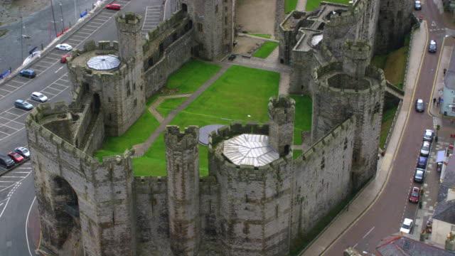 aerial caernarfon castle, wales - circa 11th century stock videos & royalty-free footage