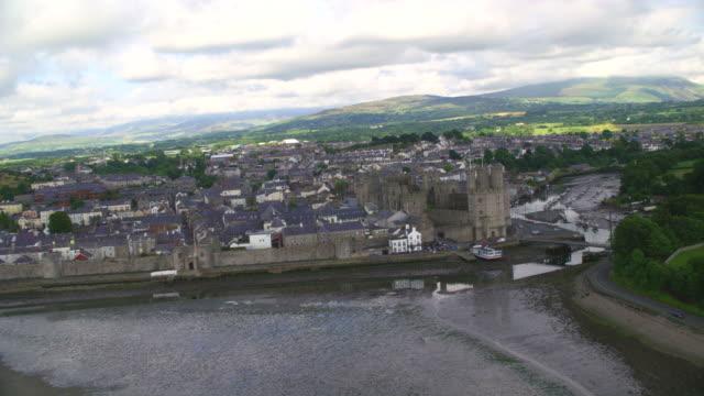 aerial caernarfon castle, wales - tower stock videos & royalty-free footage