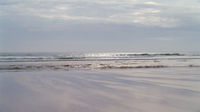 deserted beach w/light surf - horizon over water stock videos & royalty-free footage