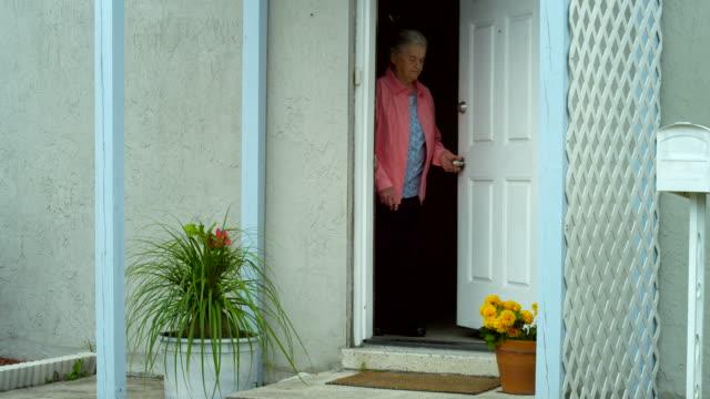 elderly woman walking outside - front door stock videos & royalty-free footage
