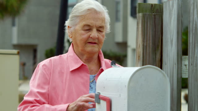 elderly woman checking mailbox - mailbox stock videos and b-roll footage