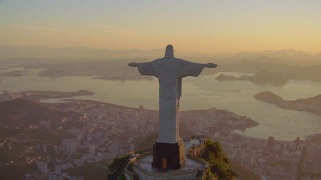 magic hour rio aerial featuring christ the redeemer - rio de janeiro stock videos & royalty-free footage