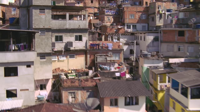 rio aerial focusing on lo-class neighborhood - slum stock-videos und b-roll-filmmaterial