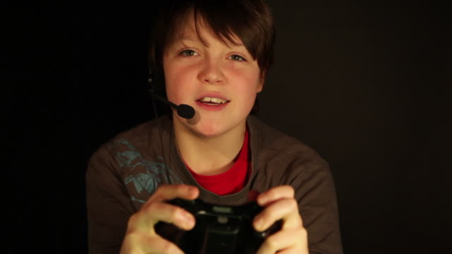 boy aged 12 playing computer game - gamer stock videos & royalty-free footage