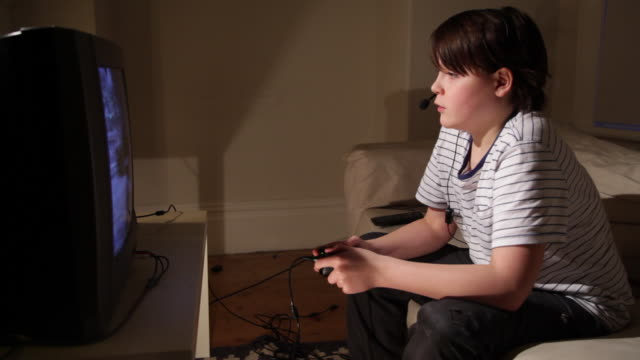 boy aged 12 playing computer game - games console stock videos & royalty-free footage