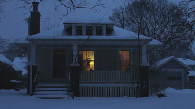 vídeos y material grabado en eventos de stock de n/x small brick/wood frame house, snow falling, lights on - ann arbor