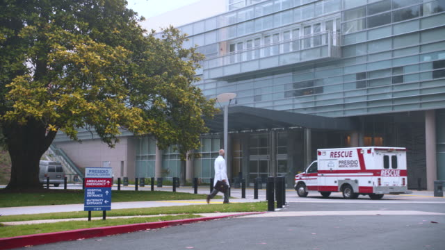 hospital w/activity, ambulance r-b; fog/mist in portion of shot - building entrance stock videos & royalty-free footage