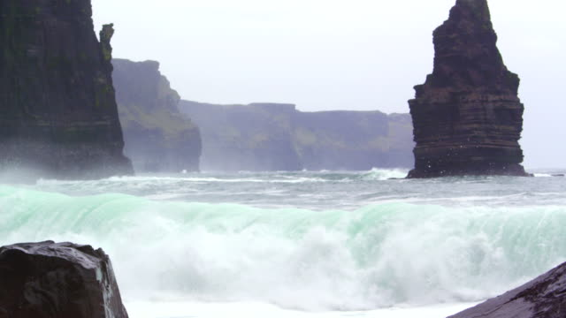 waves crash against rocky shore, ireland - power in nature stock videos & royalty-free footage