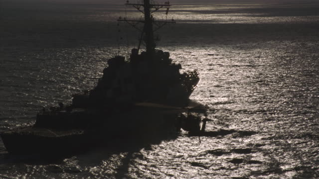 magic hour aerial helicopter approaches guided missile destroyer uss john paul jones ddg-53 at sea for landing - royal navy stock videos & royalty-free footage