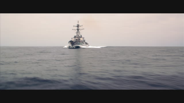 raking angle guided missile destroyer uss john paul jones ddg-53 at sea; to & by camera - warship stock videos & royalty-free footage
