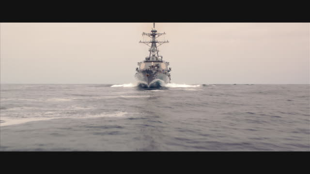 aerial guided missile destroyer uss john paul jones ddg-53 at sea; straight to & under camera - warship stock videos & royalty-free footage