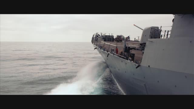 stockvideo's en b-roll-footage met aerial tracking guided missile destroyer uss john paul jones ddg-53 at sea; camera pulls up & back at end of shot - 2010
